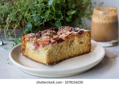 Warm Slice of Sweet Strawberry Rhubarb Cake Bread with an Espresso Latte