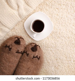 Warm soft blanket, cup of hot espresso coffee, woolen socks. Winter fall autumn cozy still life. Lazy weekend morning concept. Top view point. Copy space