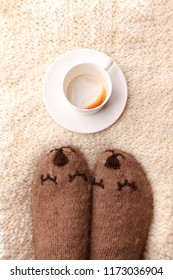 Warm soft blanket, empty cup of espresso coffee, woolen socks. Winter fall autumn cozy still life. Lazy sleepy weekend morning concept. Top view point. Copy space