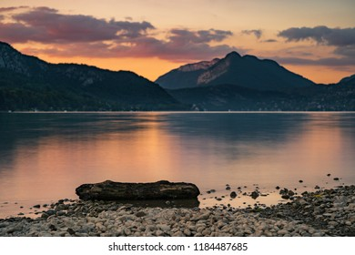 Warm and soothing sunset and mountainscape over the Lac d'Annecy