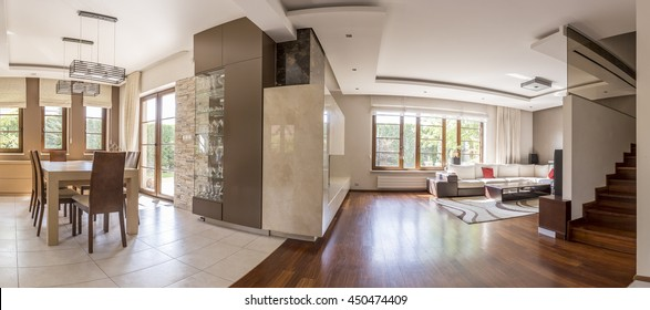Warm and spacious interior in new style with living and dining room