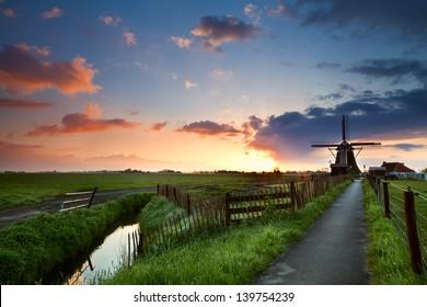 warm spring sunrise behind windmill, Netherlands