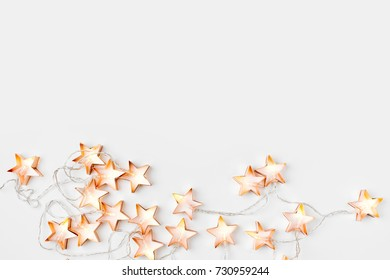 Warm star-shaped light garlands, festive decorations with copy space.  Christmas concept. Flat lay, top view