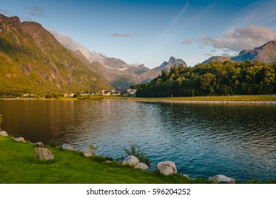 Warm summer evening in the mountains against the backdrop of the lake. Norway