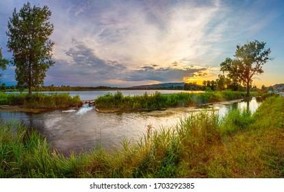 warm summer sunset on the lake