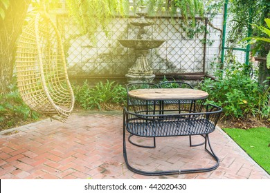 Warm sun light on table and chairs in park outdoor at cafe and hang out bar