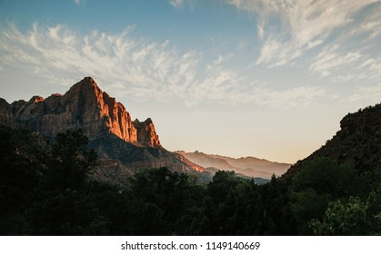 The warm sun setting on The Watchmen at Zion National Park, Utah, USA