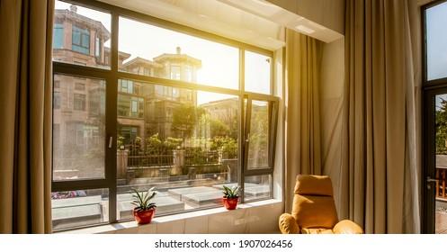 Warm sunlight shines on the indoor sofa