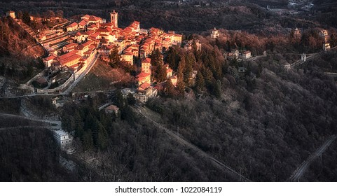 Warm sunny light on the ancient village of Sacred Mount of Varese in a winter afternoon seen from the mountain Campo dei Fiori