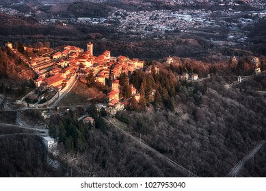Warm sunny light on the ancient village of Sacred Mount of Varese in a winter afternoon seen from aerial at the sunset