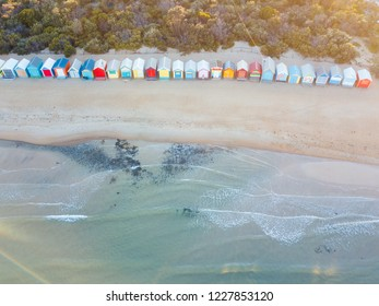 Warm sunrise light aerial view of Brighton beach bathing boxes, Melbourne, Australia.
