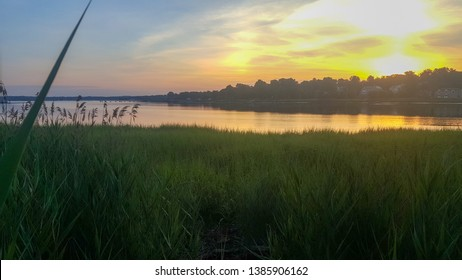 Warm sunrise overlooking meadows in Manhasset Bay Long Island, New York