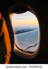 Warm sunset in airplane window