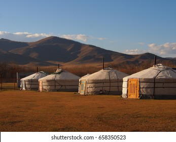 The warm sunset lights up the traditional Mongolian gers in the steppe outside Ulaanbaatar