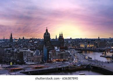 Warm sunset panorama on the basilica Saint Nicolas at night Amsterdam, Netherlands