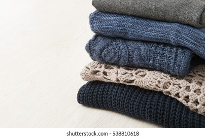 warm sweaters stacked