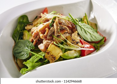 Warm Sweet Salad with Sliced Roast Chicken, Vegetables and Pineapple Isolated on White Background. Main Course Salat with Fried Turkey Fillet, Tomatoes, Cucumbers, Avocado in Elegant Restaurant Plate