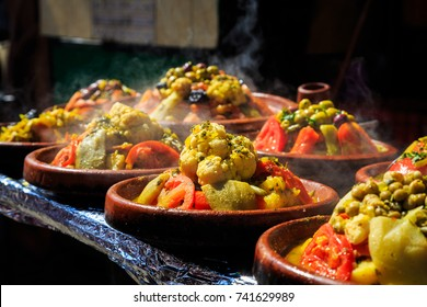 A lot of warm tagines with delicious vegetables on a market in Morocco