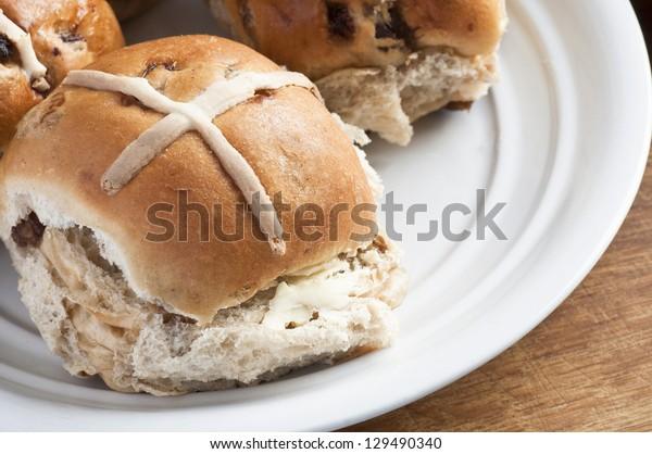 Warm toasted hot cross bun