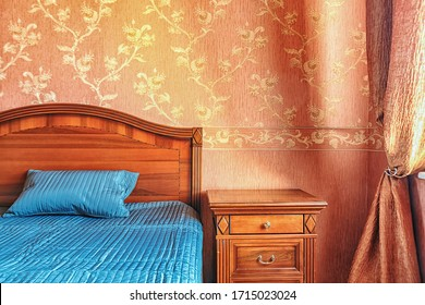 Warm tones cozy bedroom interior close up bed and night stand