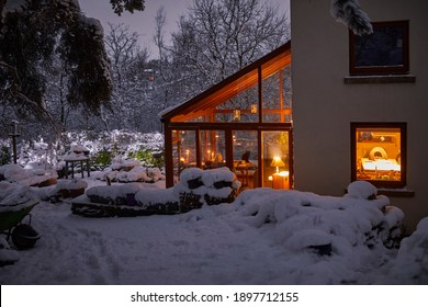 A warm welcome at dusk at the Dales farm cottage in evening snow