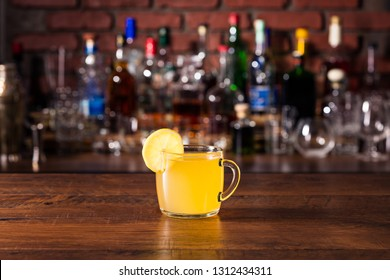 Warm Whiskey Hot Toddy Cocktail on a Bar
