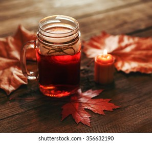 a warm winter drink with low lighting for use in holiday themes like fall, thanksgiving or christmas