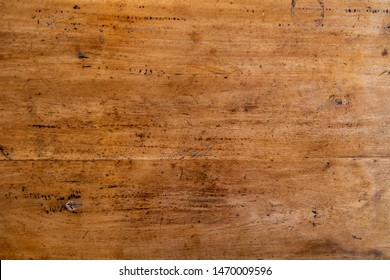Warm wooden texture photo. Timber board with weathered crack flat lay. Rustic wooden table top view. Polished wood backdrop. Grungy lumber board. Distressed wood vintage design template