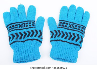 Warm woolen knitted gloves on white background