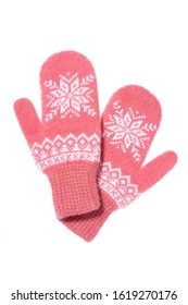 Warm woolen knitted mittens isolated on white background. Pink knitted mittens with pattern.