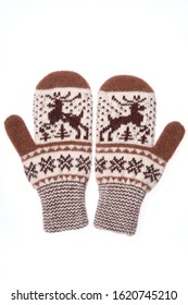 Warm woolen knitted mittens isolated on white background. Knitted mittens with pattern.