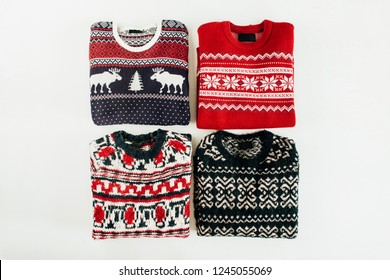 Warm woolen sweaters collage on white background. Flat lay, top view Christmas, New Year, Winter fashion concept.