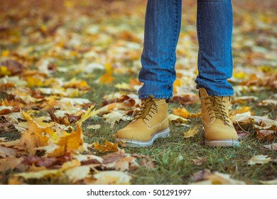 Warm yellow boots. Walking in yellow autumn leaves