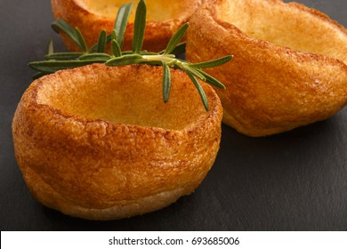 warm yorkshire pudding with rosemary on slate