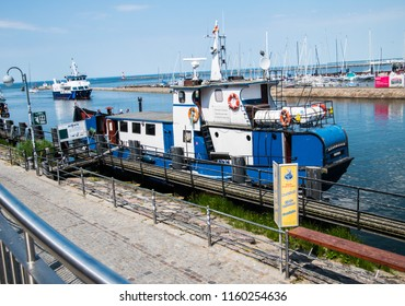 Warmemunde, Germany - June 8, 2018: Boat along the canal in the tourist town of Warnemunde, Germany