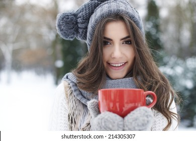 Warming up of gorgeous young woman in winter