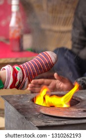 warming up the leg, a leg of a small kid trying to warm up his legs in front of the fireplace , kasol village, himachal pradesh, India