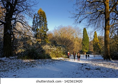 Warminster, Wiltshire / UK - February 11 2012: People out walking in the snow near Longleat, Wiltshire, United Kingdom sunny day in February, 2012.