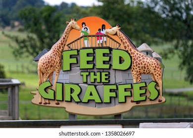 Warminster, Wiltshire UK - July 17 2014: A Feed The Giraffes sign at Longleat Safari Park