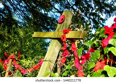 Warminster, Wiltshire / UK - November 13 2018: Warminster, UK, War Memorial 'For Your Today' Wooden Cross with Hand Knitted Poppies