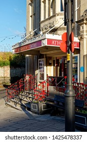 Warminster, Wiltshire / UK - November 7 2016: Hand knitted poppies decorate the Athenaeum Centre in the market town of Warminster, Wiltshire, to commemorate British and Commonwealth fallen soldiers