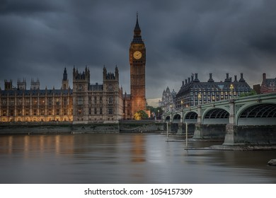 Warmly colored Big Ben and Houses of Parliament on a calm and cloudy evening in London, England, HDR version