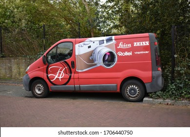 Warmond / The Netherlands - April 6 2020: Red van with camera signage om the side with brandnames Leica, Zeiss, Rollei, Voigtlander