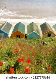 A warm-toned image of some traditional beach huts at Southwold, UK