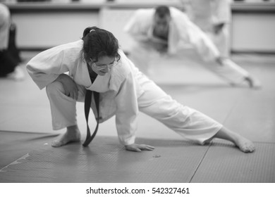Warm-up and stretching of muscles during training Aikido