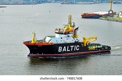 Warnemunde, Germany – July 21, 2017: The ocean-going salvage tug BALTIC travels in the harbor basin of the Baltic Sea port Rostock Warnemunde.