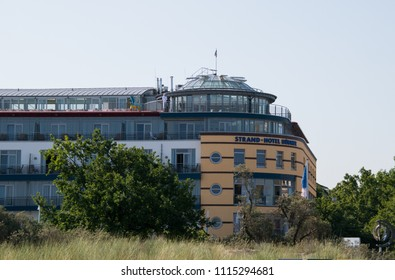 Warnemunde, Germany - June 8, 2018: Strand- Hotel Hubner is a luxury hotel located along the boardwalk by the beach in the vacation resort area of Warnemunde, Germany as seen on this date