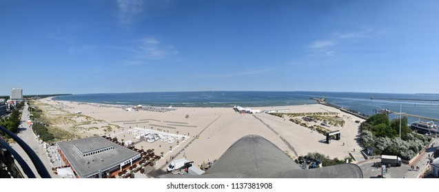 Warnemunde, Germany - June 8, 2018: Panoramic view of beach and Baltic Sea in coastal town of Warnemunde, Germany on this date