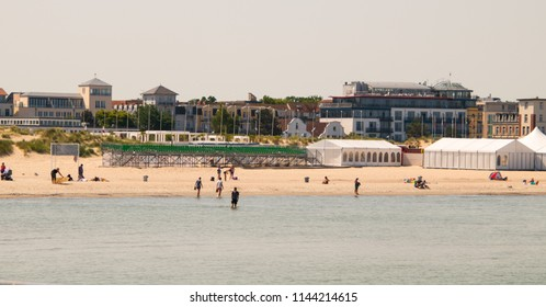 Warnemunde, Germany - June 8, 2018: view from the water of the Sport Beach Arena bleachers were many athletic events take place on the beach