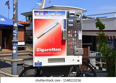 Warnemunde, Germany - June 8, 2018: This cigarette machine was seen in the down town area of the tourist town of Warnemunde, Germany